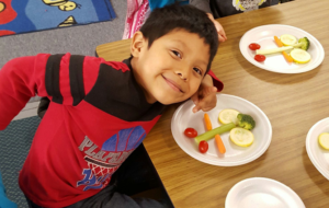 smiling child eating healthy snacks
